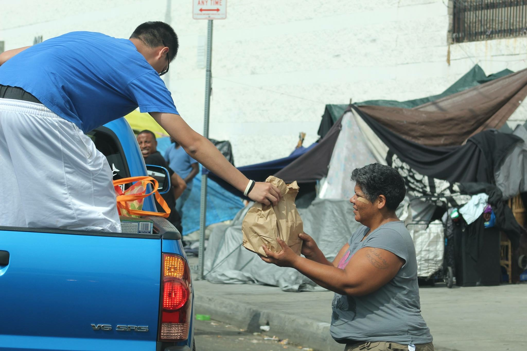 giving out bags