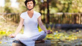 middle aged woman yoga meditation